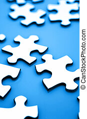 Puzzle - Jigsaw puzzle pieces on blue