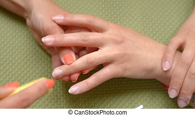 Cosmetologist cleans nails, nail file.Beautician make...