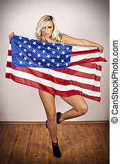 Beautiful blonde - Beautiful young girl holding the flag of...
