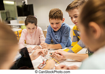 happy kids with invention kit at robotics school -...