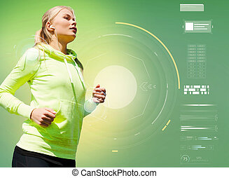 young woman with earphones running over green - fitness,...