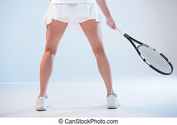 woman with tennis racket - back view of woman in tennis...