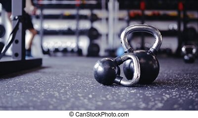 Pair of kettlebells laid on the floor in gym - Pair of...
