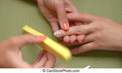 Training lesson manicure, cleans nails - Cosmetologist...