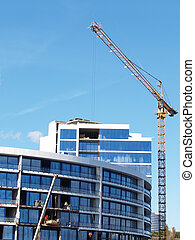 corporate buildings - Cranes on a building site of buildings...
