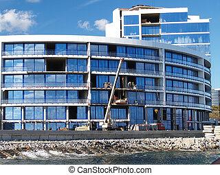 corporate buildings - Residential building against dark blue...