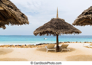 palapa and sunbeds on exotic tropical beach - travel,...