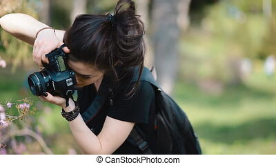 Photographer work with model outdoor - Young woman...