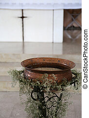 Ancient Small baptismal font in copper inside the church