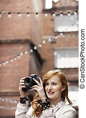 Freelance photographer taking pictures - Attractive ginger...