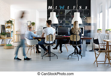 People working in creative environment