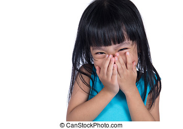 Asian Chinese little girl laughing and covering her mouth