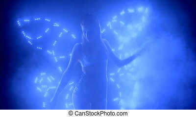 Dancer posing in led costume with butterfly wings - Dancer...