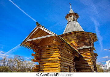 Spring view of the wooden Travel Tower of the Nikolo-Korelsky Monastery in the Kolomenskoye Museum at sunny day