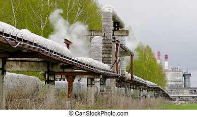 industrial pipelines on pipe-bridge from which emanate jets...