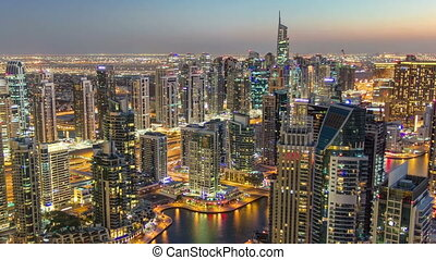 Dubai Marina with modern towers from top of skyscraper...