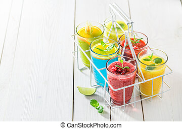 Delicious smoothie with fresh fruits on white table
