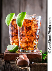 Sweet Long Island drink with cola and citrus fruits