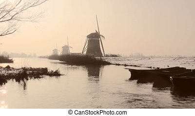 Windmills in Wintersun in Holland