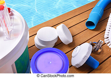Chemical products and tools for pool maintenance elevated...