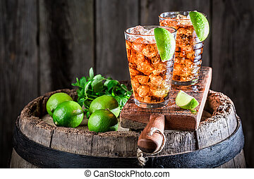 Tasty Long Island drink with lime and ice