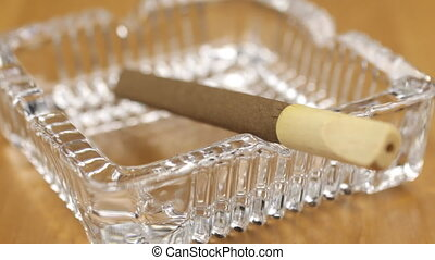Focus on the cigar and on the glass ashtray. Selective focus