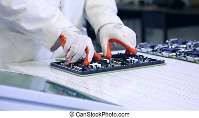 Workers are manufacturing Circuit Boards in Electronics...