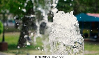 Clear water fountain in park slow motion footage