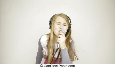 beautiful young expression girl singing in microphone