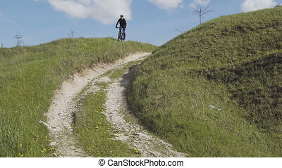 Man Riding Bicycle Mountain Grass Hill - Young sports man...