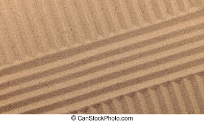 Rotation of lines made of sand. View from above