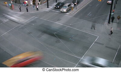 City intersection. Timelapse. - A busy road intersection in...
