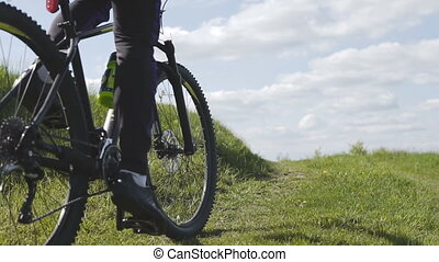 Man Riding Bicycle - Young sports man riding bicycle on...