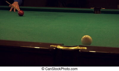 Guy plays Russian Billiards and hits the ball in the hole