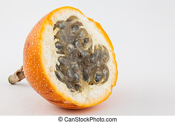 Sweet granadilla (Passiflora ligularis) isolated in white...