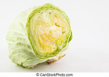 Crisphead lettuce (Lactuca sativa) isolated in white...