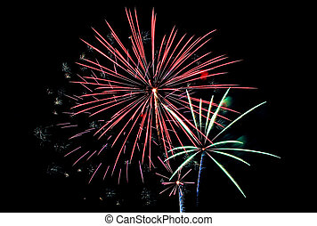 Red, white and blue fireworks light the sky on the fourth of...