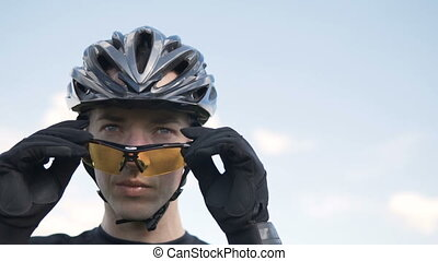 Biker Wears Yellow Sunglasses - Closeup young sports man...