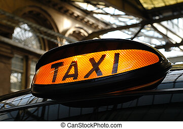 Taxi at the Station - Taxi light on a traditional black cab....