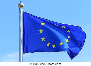European Union flag on the blue sky