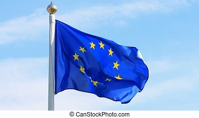 Flag of European Union waving on blue sky