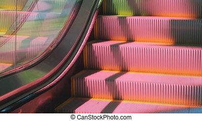Colourful escalator. Closeup.