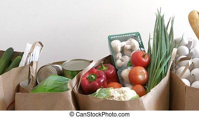 Fresh food - Groceries paper bags filled with variety of...