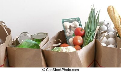 buy fresh food concept - Groceries paper bags filled with...