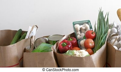 Consumption of food products - Groceries paper bags filled...