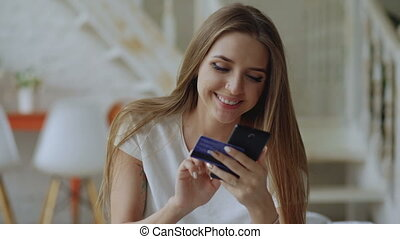 Beautiful young woman have online banking and shopping using...