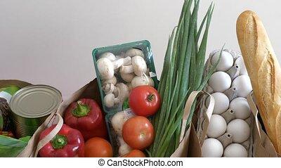 Buying fresh supermarket groceries - Groceries paper bags...