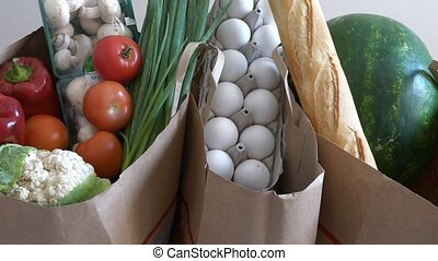 Groceries from top view - Groceries paper bags filled with...