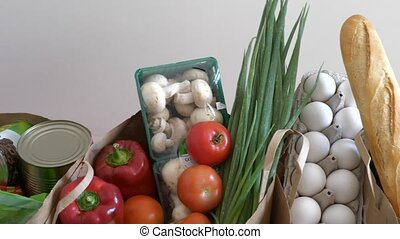 Top view on fresh food products - Groceries paper bags...