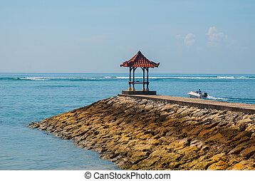 Beautiful gazebo pavilion on the beach Benoa. Bali,...